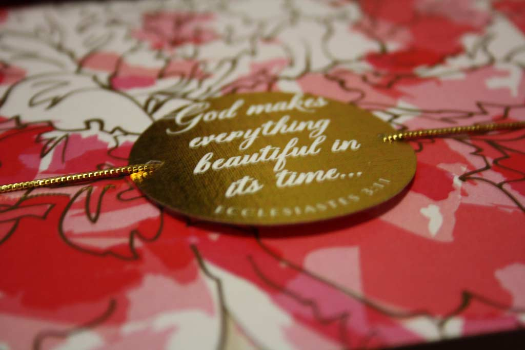 A very special gold tag on a wedding invitation